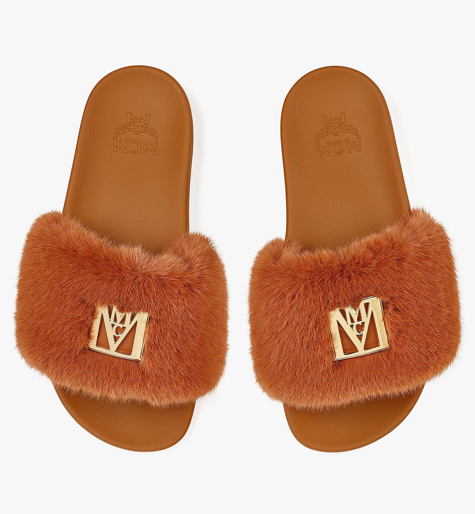 MCM Slides mit Kunstfell und Logo für Damen Cognac MESBASX04CO035 Noch mehr sehen 4