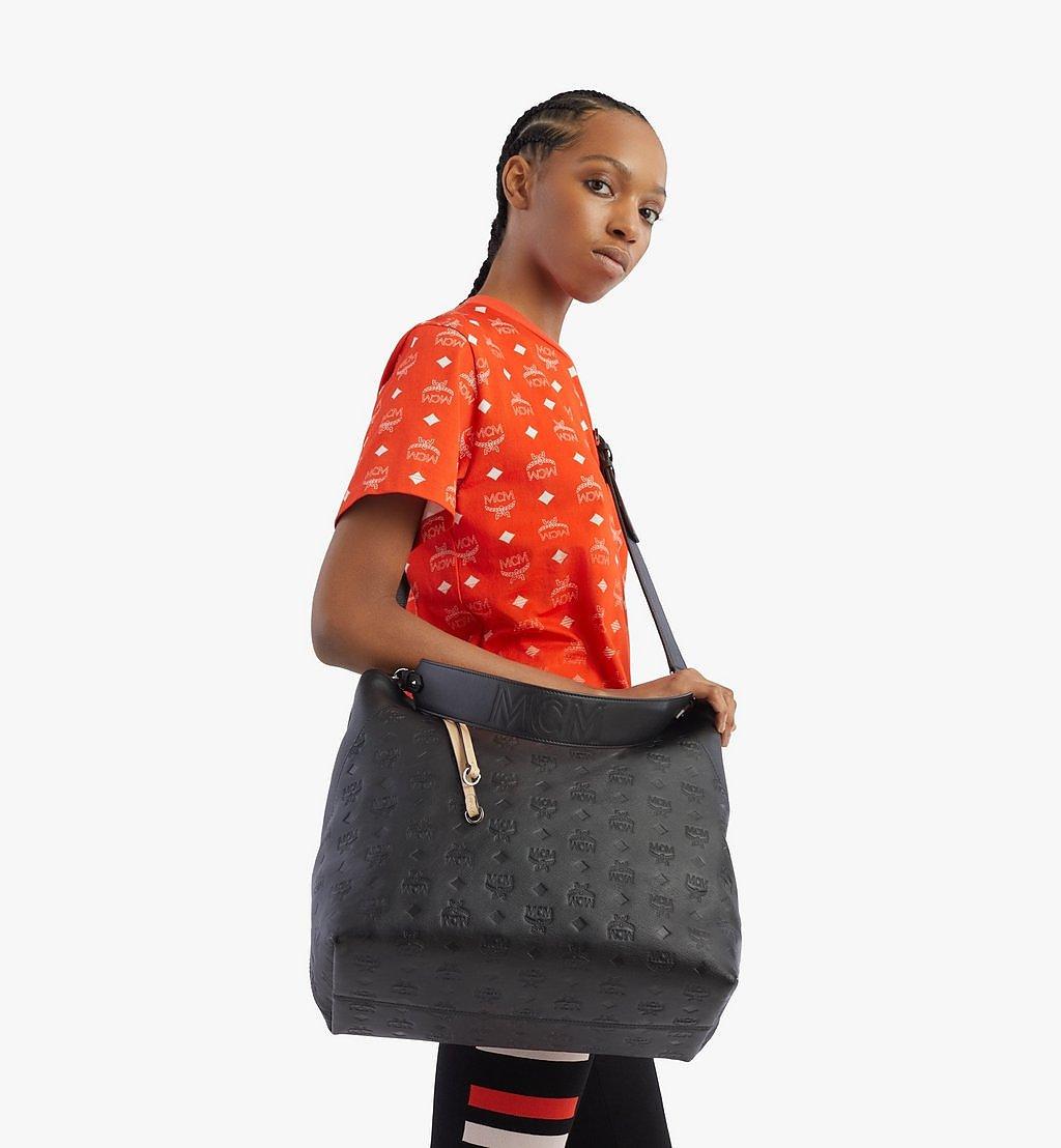 MCM Klara Hobo-Tasche aus Leder mit Monogramm Cognac MWH9SKM75BK001 Noch mehr sehen 2