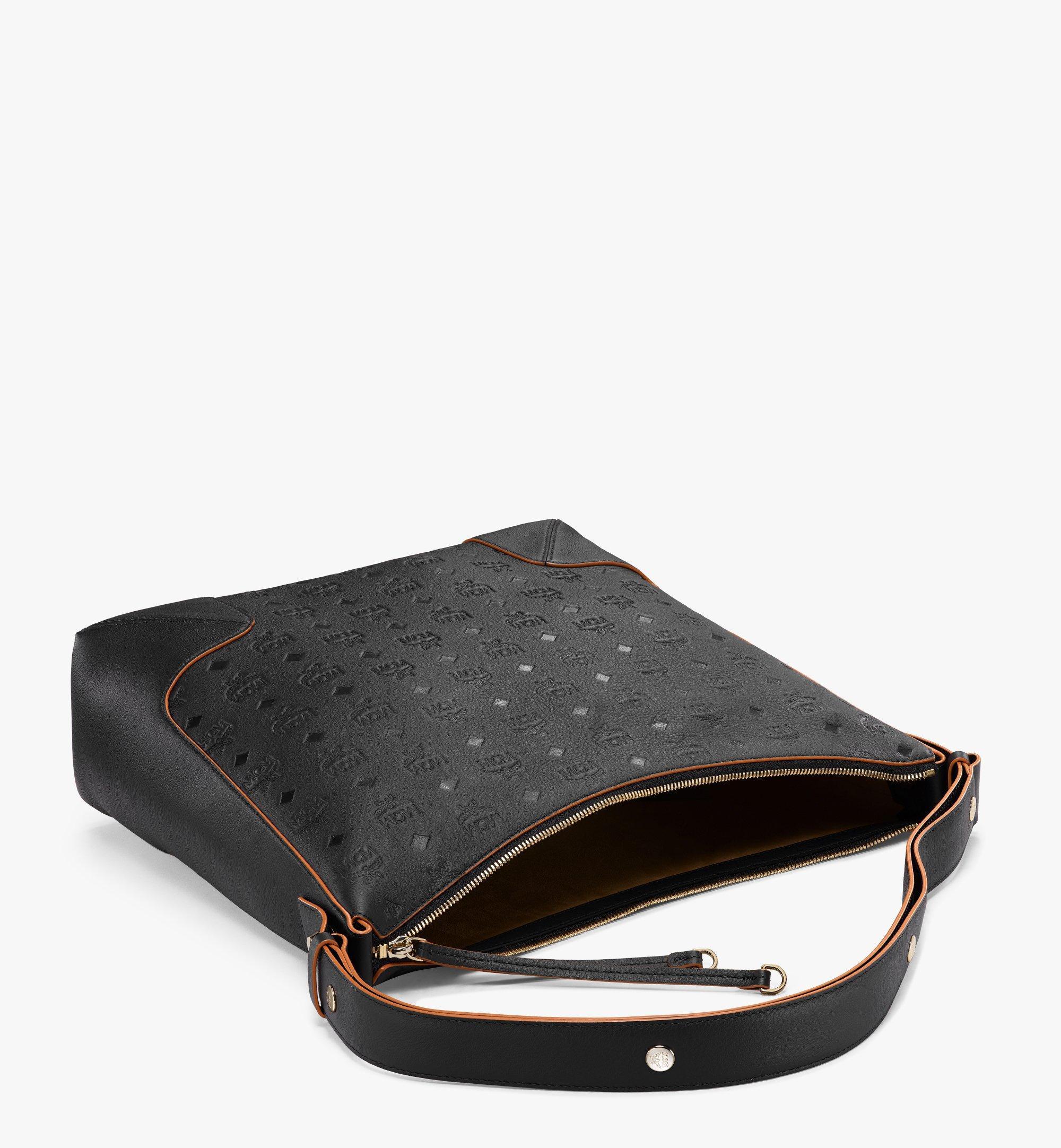 MCM Klara Hobo-Tasche aus Leder mit Monogramm Black MWHBSKM03BK001 Noch mehr sehen 2