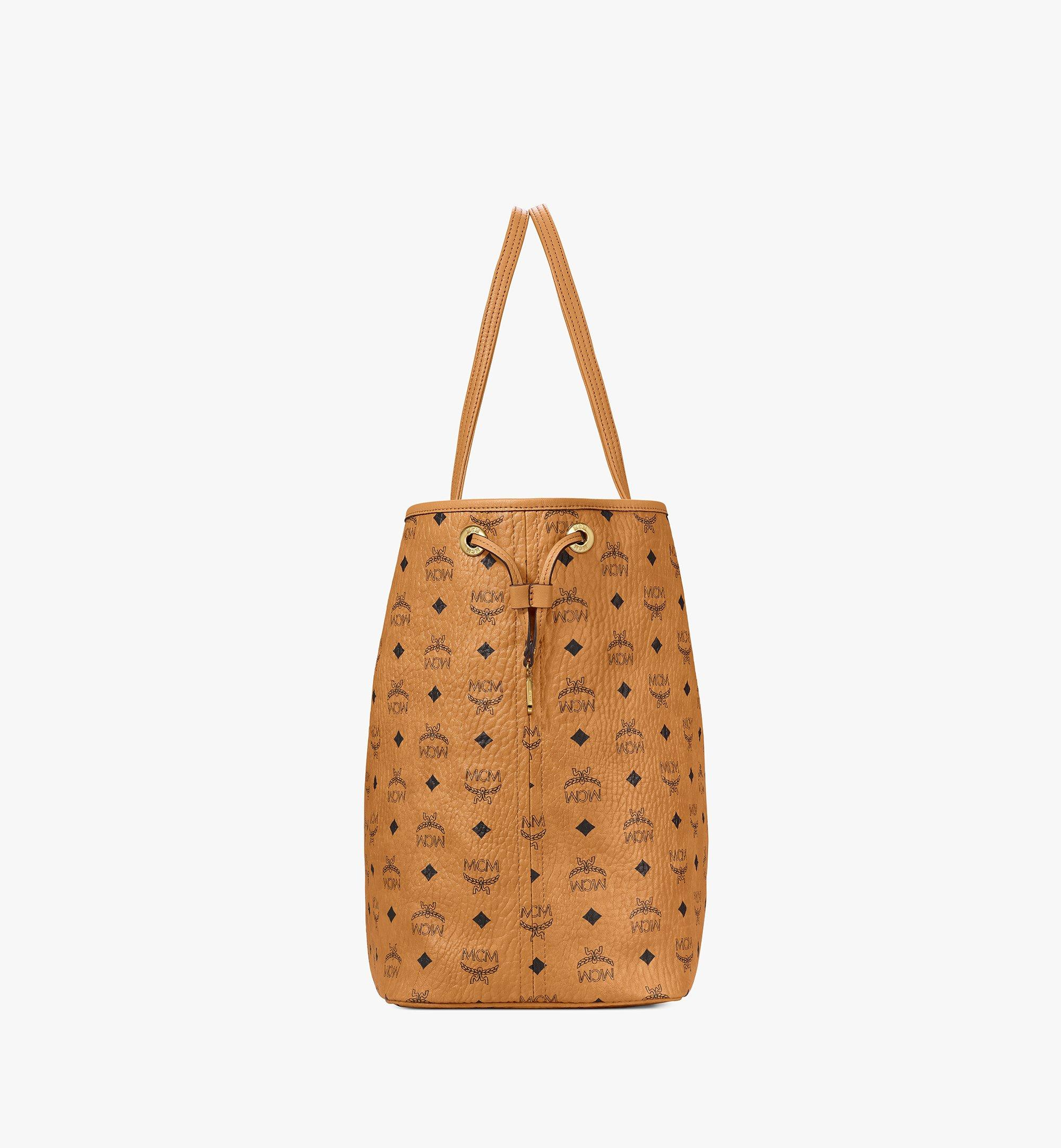 Large Liz Wendeshopper in Visetos COGNAC | MCM® DE