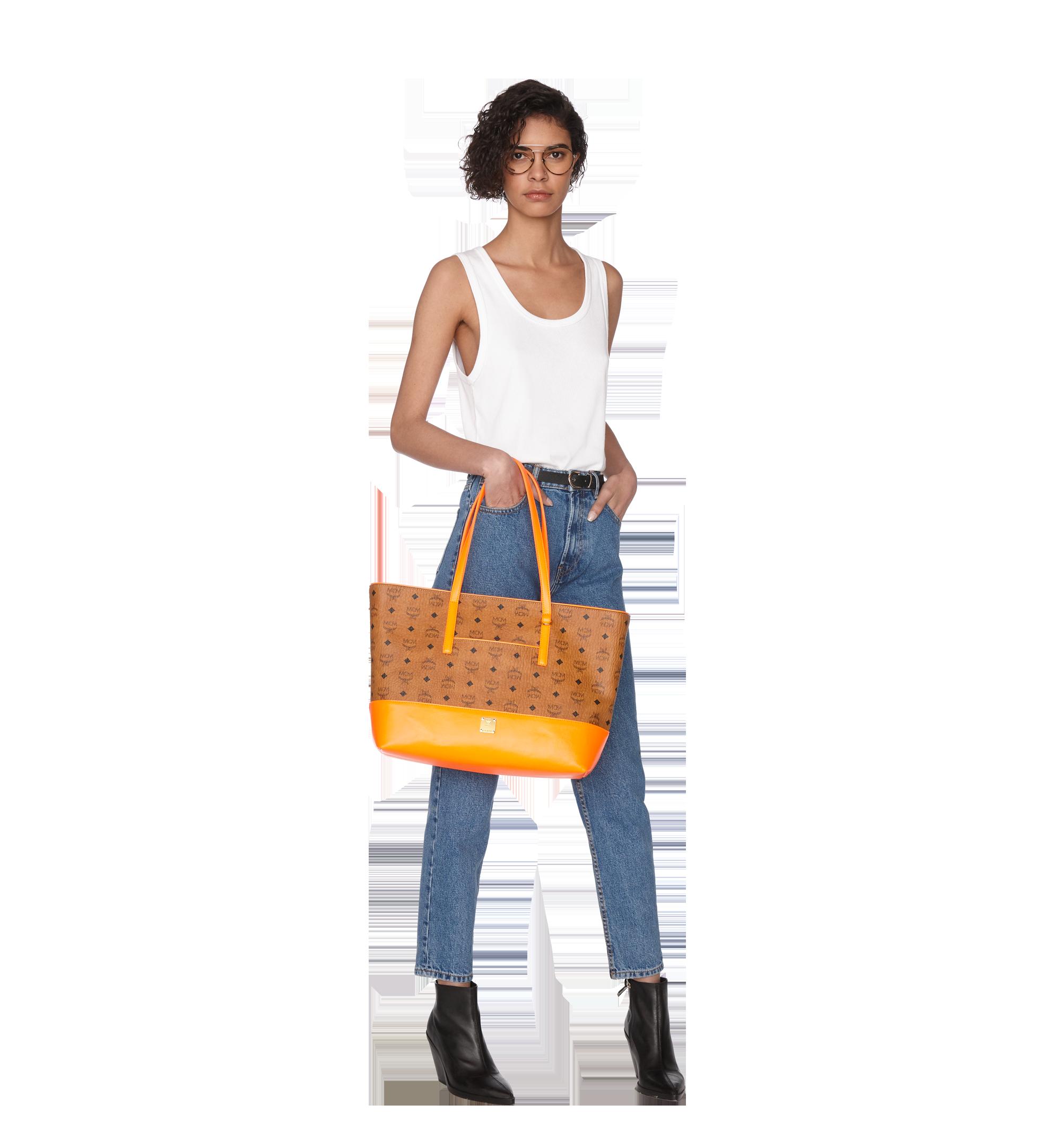 Medium Geonautic Shopper in Visetos Cognac | MCM® DE
