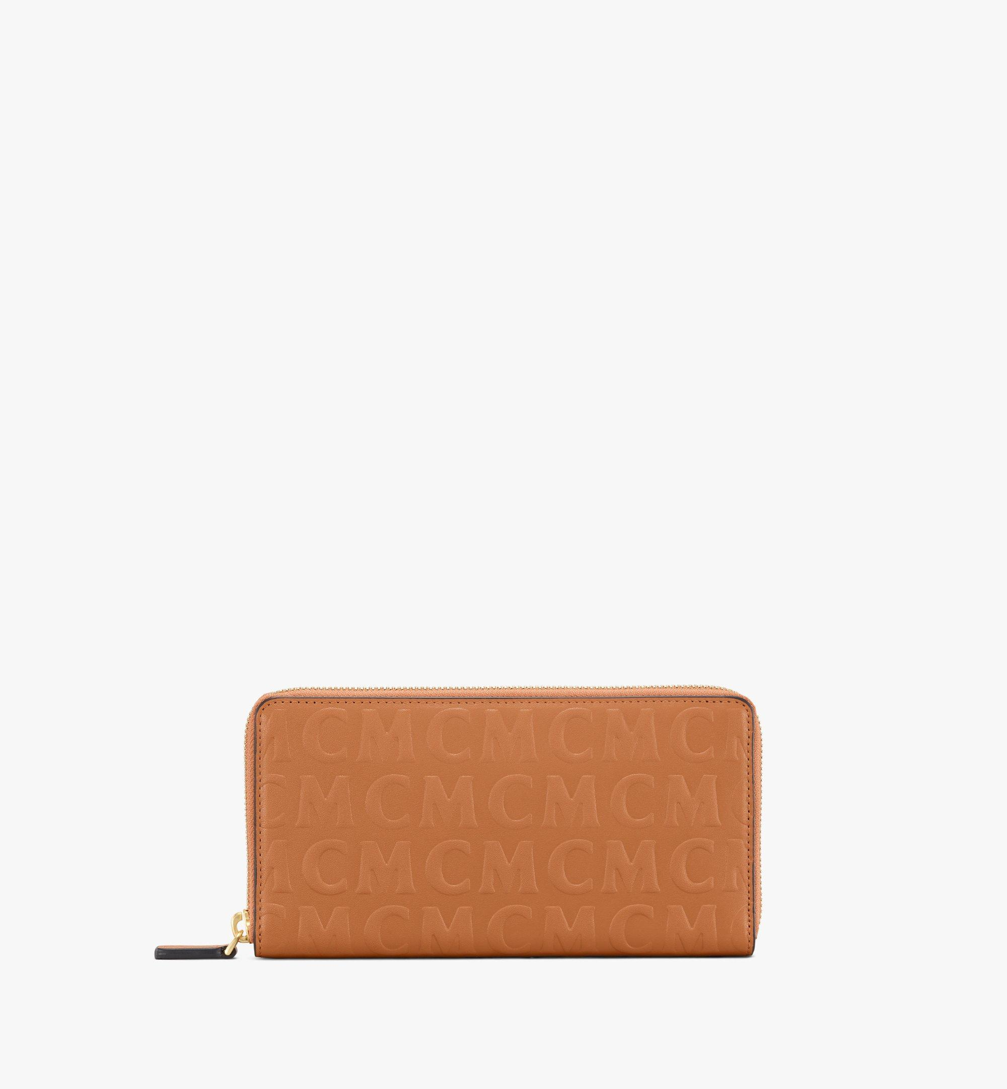 MCM Lederbrieftasche mit Rundum-Reissverschluss und MCM-Monogramm Cognac MYLAAMD01CO001 Noch mehr sehen 1