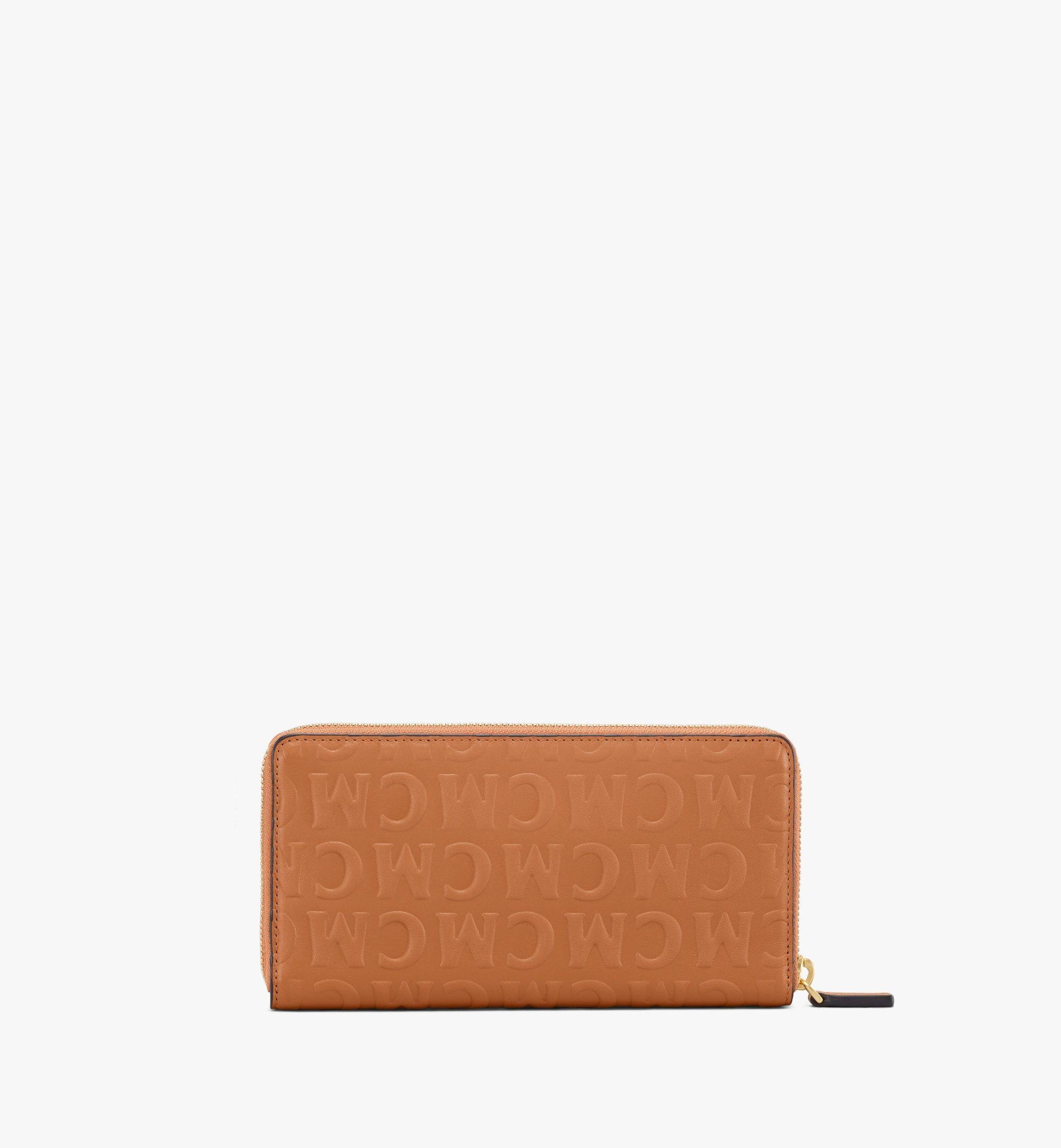 MCM Lederbrieftasche mit Rundum-Reissverschluss und MCM-Monogramm Cognac MYLAAMD01CO001 Noch mehr sehen 2