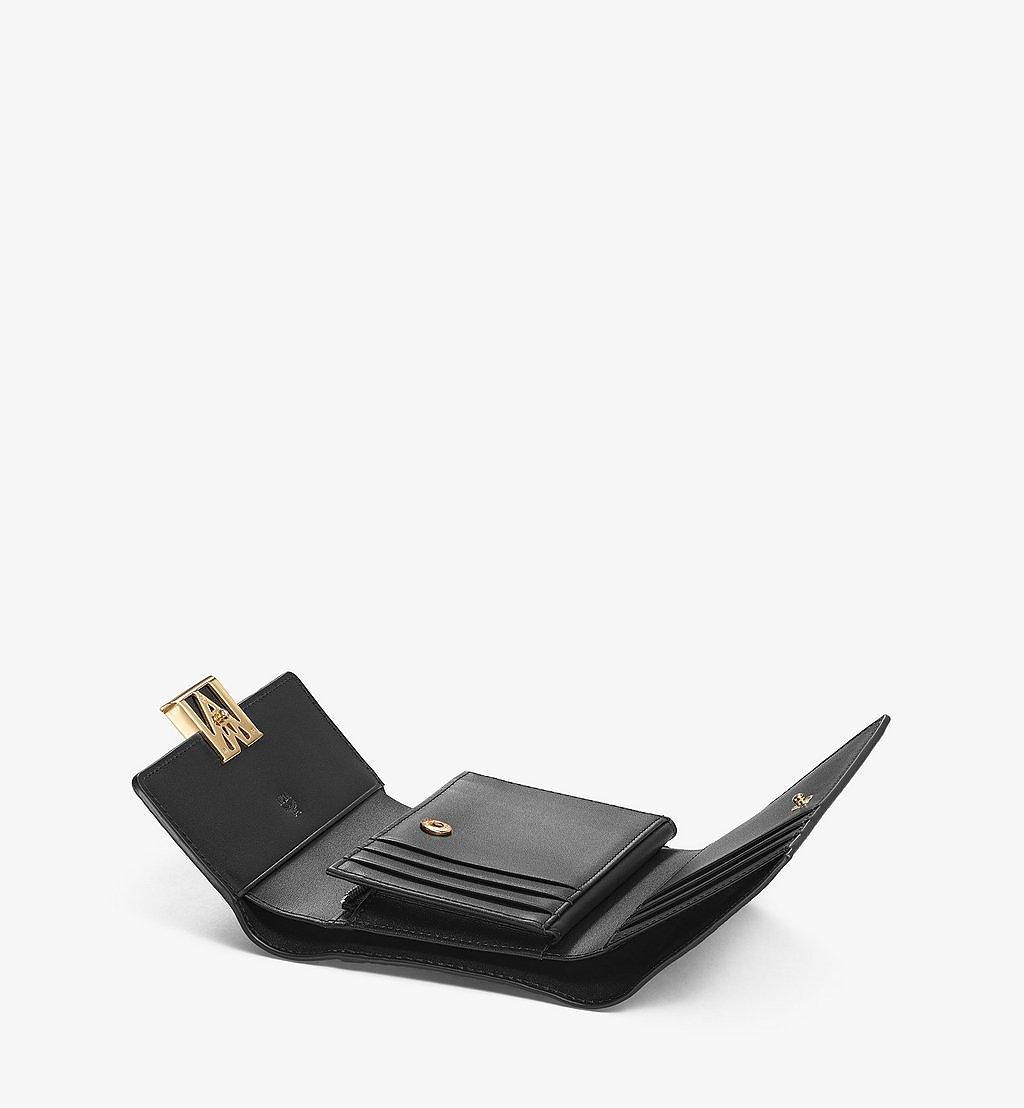 MCM Dreifach gefaltete Mena Brieftasche in Visetos Leder Block Black MYSAALM01BK001 Noch mehr sehen 1